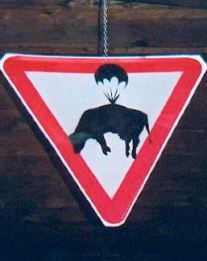 2003:07:18 - original - sign w cow on a parachute - Turf War -
