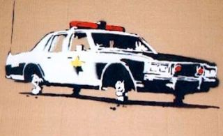 2003:07:18 - Original - Turf war - cop car on bricks