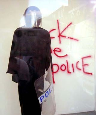 2003:07:18 - Original - Turf War - Mannequin w fuck the police - artnet
