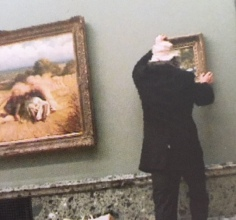 Hanging his work