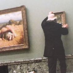 Hanging his work