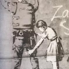 2007:12:24 - SA - Santas Ghetto 2007 - Betlehem - Girl frisking soldier - Where's Banksy p95