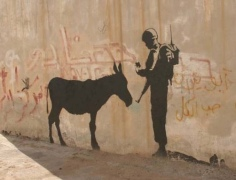 2007:12:24 - SA - Santas Ghetto 2007 - Donkey w soldier - Betlehem - Doin Nissenbaum:MCT