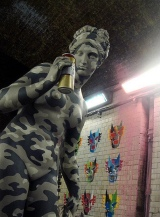 Banksy statue at Cans