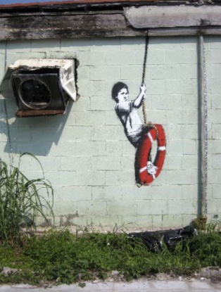2008:8 - SA - New Orleans - Child w life preserver