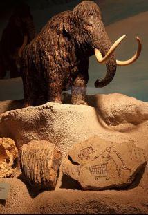 2009:7 - Original - Sculpture - BvBM - Mamouth w caveman rock - source unknown