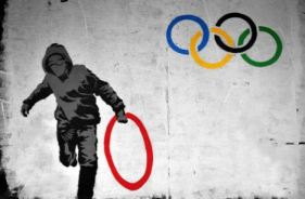 2012:7:23 - London - Hooded man stealing Olympic ring - weburbanist