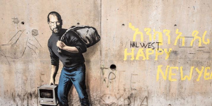 "This picture taken on December 12, 2015 shows a street art graffiti representing Steve Jobs, founder and late CEO of Apple, by elusive British artist Banksy at the migrant camp known as the ""Jungle"" in Calais, northern France. / AFP / PHILIPPE HUGUEN / RESTRICTED TO EDITORIAL USE - MANDATORY MENTION OF THE ARTIST UPON PUBLICATION - TO ILLUSTRATE THE EVENT AS SPECIFIED IN THE CAPTION (Photo credit should read PHILIPPE HUGUEN/AFP/Getty Images)"