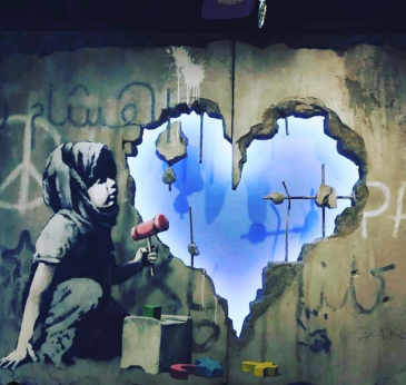 20190201 - Instalation - Detail of boy w heartshaped hole in the wall - banksyarchive
