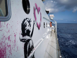 Detail from Banksy rescue boat Louise Michel. Photo Ruben Neugebauer